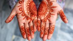Girl displaying her Mehndi (henna) on occasion of Islamic festival of Eid-ul-Fitr