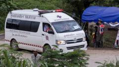 An ambulance leaves the Tham Luang cave area