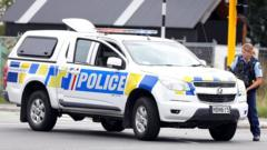 This picture released by Radio New Zealand shows a police officer cordoning a street near the mosque after a firing incident in Christchurch on March 15, 2019
