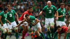 Ireland's Jonny Sexton tackled by Wales' Rhys Webb during the World Cup Warm Up Match