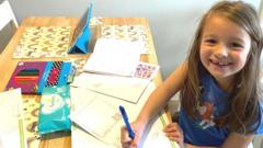 emilia-writing-a-letter-at-the-table
