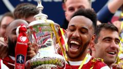 Pierre-Emerick Aubameyang of Arsenal celebrates with the trophy during the FA Cup Final match between Arsenal and Chelsea at Wembley Stadium