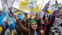 Supporters of Turkey's main pro-Kurdish HDP party cheer during a campaign rally in Ankara in 2019