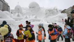 Children looking at the sculptures of the 67th Sapporo Snow Festival