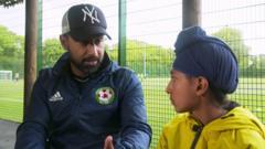 Balrag-interviewing-Imrul-Gazi,-a-grassroots-coach