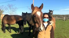 Delphine Chriqui with her horses