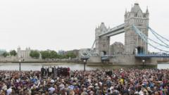 People hold a silence for the London Bridge attack victims