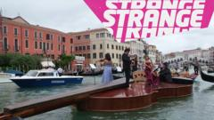 A giant floating violin with a string quartet on board