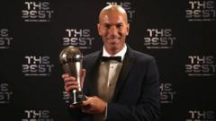 Zinedine Zidane poses with 'the Best' trophy