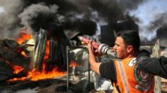 A Palestinian firefighter participates in efforts to put out a fire at a sponge factory on Monday