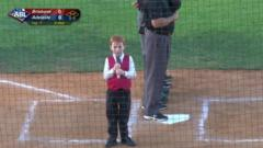 Boy singing national anthem