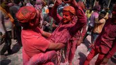 People celebrate Holi, the spring festival of colours, during a gathering at a temple in Uttar Pradesh state in India