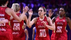 England Netball team celebrating.