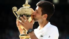 Novak Djokovic with Wimbledon trophy in 2018