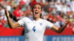 England's Fara Williams celebrates after scoring on a penalty shot against Japan during the first half of a semifinal in the FIFA Women's World Cup soccer tournament, Wednesday, July 1, 2015, in Edmonton, Alberta, Canada.