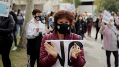 """A demonstrator attends a protest against the regional government""""s measures to control the spread of the coronavirus disease (COVID-19), at Vallecas neighbourhood in Madrid, Spain, October 4, 2020."""
