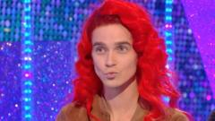 Joe Sugg wearing a red wig