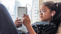 child-on-tablet.