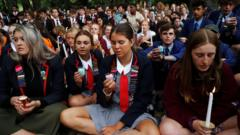 Students gather in a vigil to commemorate victims the Christchurch mosque shooting