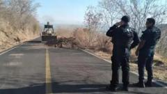 Road to Aguililla being cleared of debris by the security forces