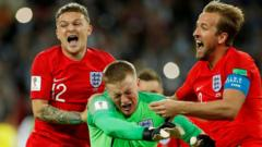 England players celebrate after penalty win against Columbia