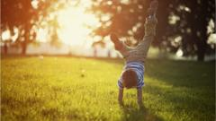 A-boy-does-a-handstand-outside.