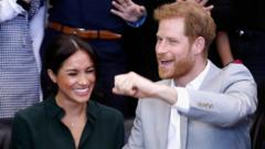 A grinning Duke and Duchess of Sussex