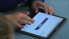 Kids look at tablet computer