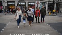 pedestrians crossing road.