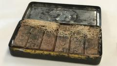 An antique tin with bars of chocolate