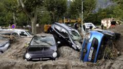 This general view shows a pile of vehicles on a street in Breil-sur-Roya, south-eastern France