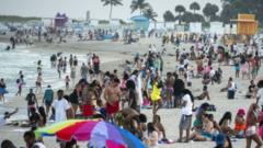 Large crowds of people gather during spring break, in Miami Beach