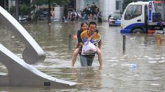 Woman and man walk through floodwater