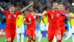 Kieran Trippier (left) and England's Harry Kane celebrate their side winning the penalty shoot out during the FIFA World Cup 2018