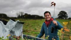 Matt Baker holding a sapling.