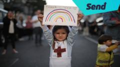 girl-nurse-costume-holding-rainbow-thank-you.