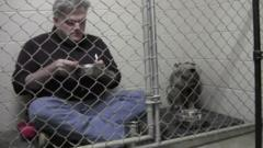 Dr Mathis and Graycie in the cage