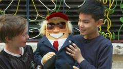 Children with a Donald Trump puppet.