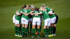 Female players in a huddle
