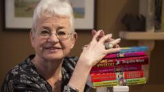 Jacqueline Wilson next to some of her books