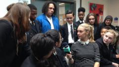 School kids discuss the issue of racism with anti-bullying campaigner Alex Holmes