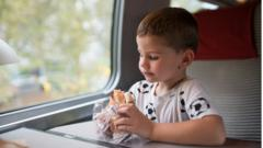 boy-eating-on-train.