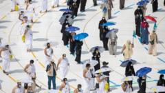 Muslim pilgrims maintain social distancing as they circle the Kaaba at the Grand mosque during the annual Haj pilgrimage, 29 July 2020