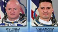 Two astronauts take their first spacewalk from the ISS