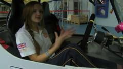 Girl in solar powered car.