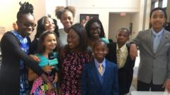 Ayshah with kids at Ebenezer Baptist church service