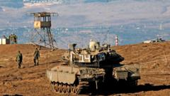 File photo showing Israeli soldiers and armoured vehicles are pictured near the frontier with Syria in the occupied Golan Heights (19 November 2019)