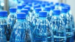 Lots-of-blue-plastic-bottles.