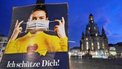 "A poster reads ""I protect you"" during the local coronavirus disease (COVID-19) lockdown in Dresden, Germany, December 14, 2020"