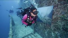 Divers check out an art exhibition